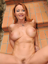 Milf Pics: Hot brunette Anilos Janet Mason showing all her glory and toying her own pussy on the stairs