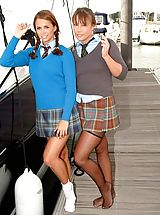 Outdoors Pics: Two sexy girls in college uniforms with stockings