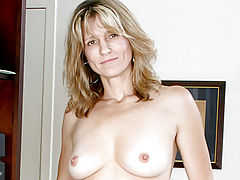Milf Vids: Brown eyed cougar shows off her perky tits