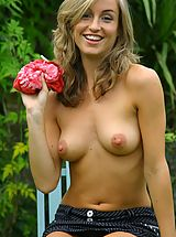 naked chick, Melanie in the garden wearing a red tie-die top with a pinstripe skirt with white cotton panties.