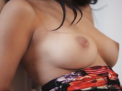 Big breasted Megan Salinas pulls her miniskirt aside to show her bald pussy and rub her horny clit to chase a big orgasm