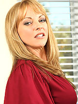 Milf Pics: Hot momma Shayla Laveaux spreads her legs wide open to flaunt her pink pussy on the couch