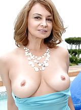 puffy nipples photos, Anilos housewife moistens her glass toy and fucks her pink pussy outdoors