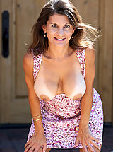 Naked Anilos, Elegant mature woman flaunts her curvy bod outdoors in a sundress
