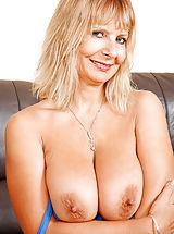 Big Nipples, Horny Anilos Alex pinches her big boobs and spreading her pink pussy on the couch