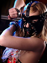 Fantasy Pics: Fantasy Girl Slave girl in leather costume and leather mask spreading her legs
