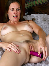 Naked Hairy, Anilos Laila fucks her cougar snatch with a purple toy in bed