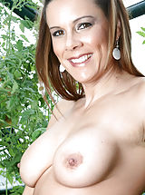 Erected Nipples, Brunette Anilos Victoria loves to expose her experienced shaved pussy while she hangs out in her garden