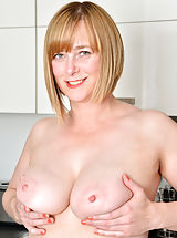Milf Nippels, April - Cock hungry mom gets naked and finger fucks her hairy twat