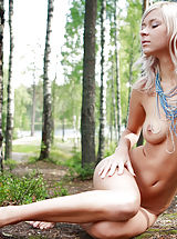 Sexy teen exposes her body right in the forest without thinking that somebody could see her.
