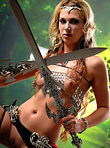 Naked True Beauty, Sexy topless blonde amazon babe posing with two swords and masturbates