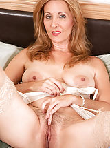 Erect Nipples, Sex starved cougar Camilla shoves a big suction cup dildo deep inside of her hairy juice box