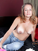 naked sluts, Busty Anilos Kashmir peels off her tight jeans and masturbates