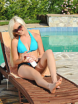 Dolly Spice removes her swimsuit and spreads her legs displaying her teen pussy