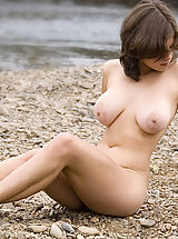 Large Areolas, Brunette with big breasts posing naked on the beach